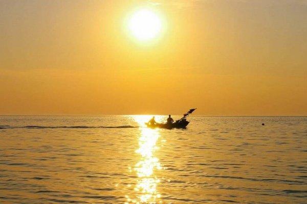 sunset in Nida with yacht Ausrine